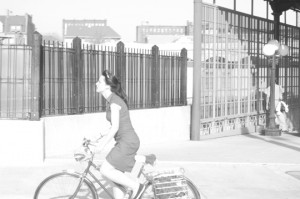 Overexposed woman on a bike