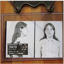 Black and white mugshot of woman with long hair from the 1960's