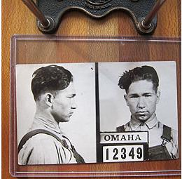 Black and white mugshot of man in overalls from the 1930's