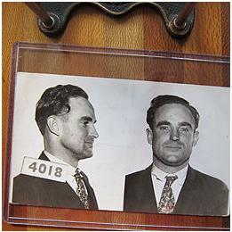 Black and white mugshot of man in suit and tie from the 1930's