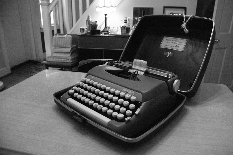 Black and white photo vintage Sterling typewriter on table