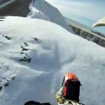front tire of dirtbike in snow on mountain top