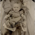 old black and white photo of child with hidden mother