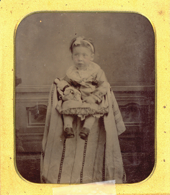small child black and white photo sepia tone with hidden parent