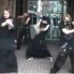 Teenagers in black dancing