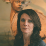 Picture of Kate Clark in front of one of her sculptures