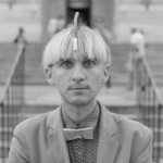 Black and white screen capture of Neil Harbisson syborg