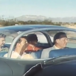 1950s famil in the car of the future