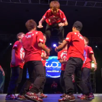 Japanese dance crew performs a trick.