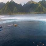 Boats in water surf around Tahiti