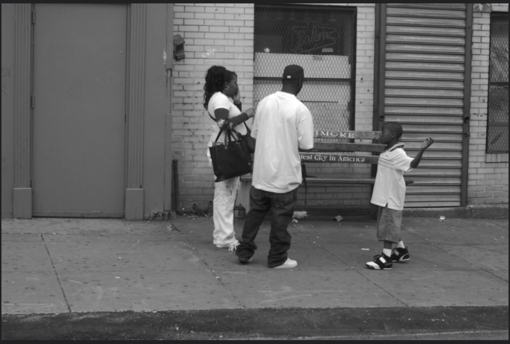 Baltimore family standing in front of a bench