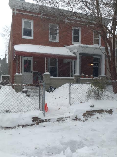 Front walk of house shoveled mid blizzard.