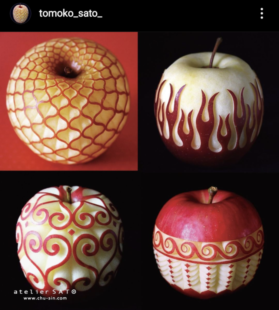 Four apple carvings by Tomoko Sato